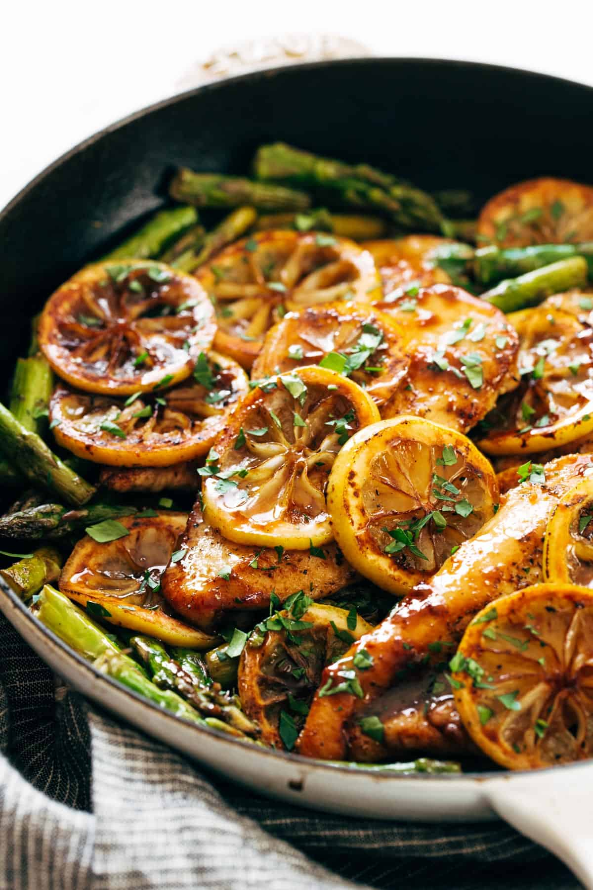 Lemon chicken with asparagus in a pan