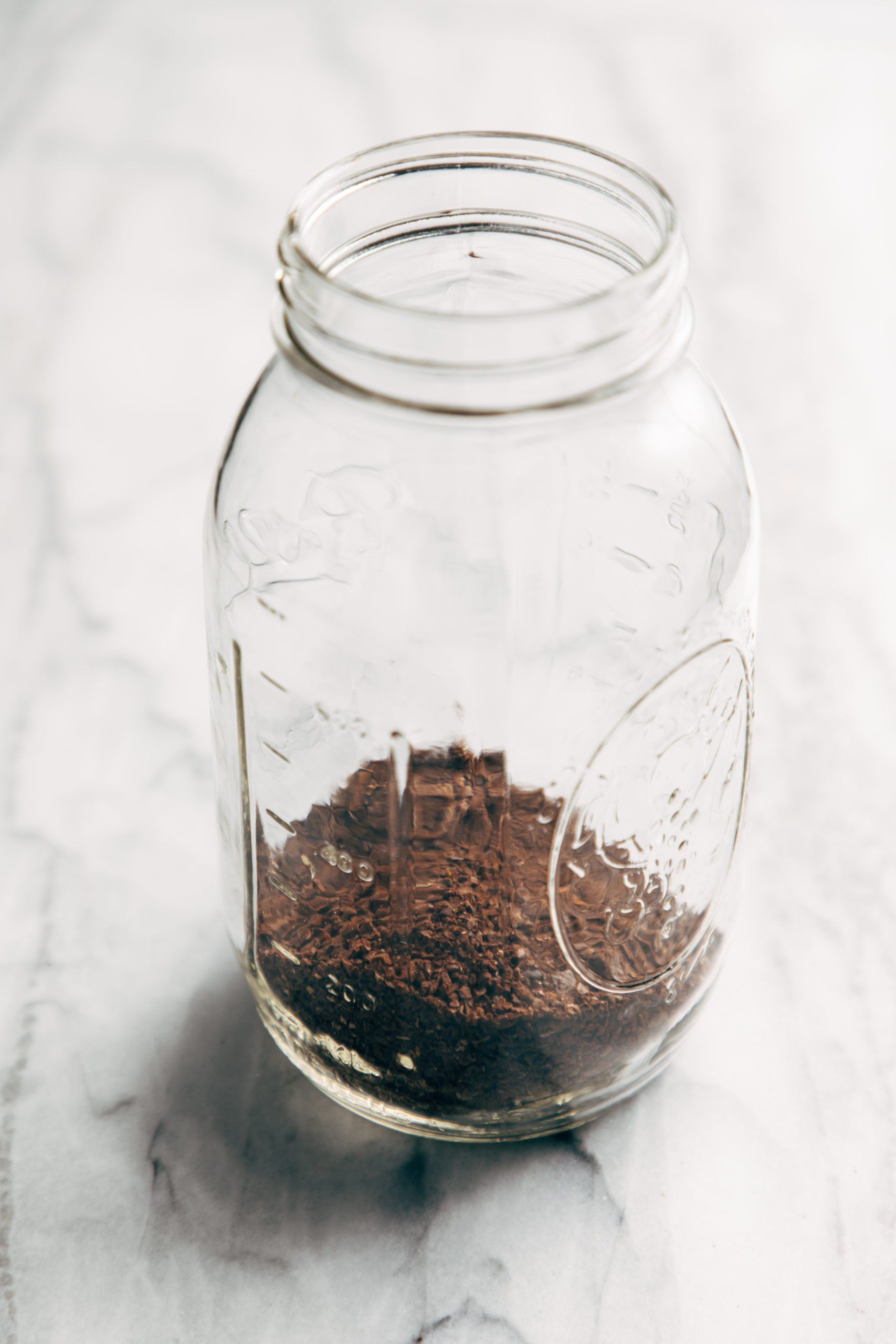 Coffee grounds in a jar for cold brew coffee
