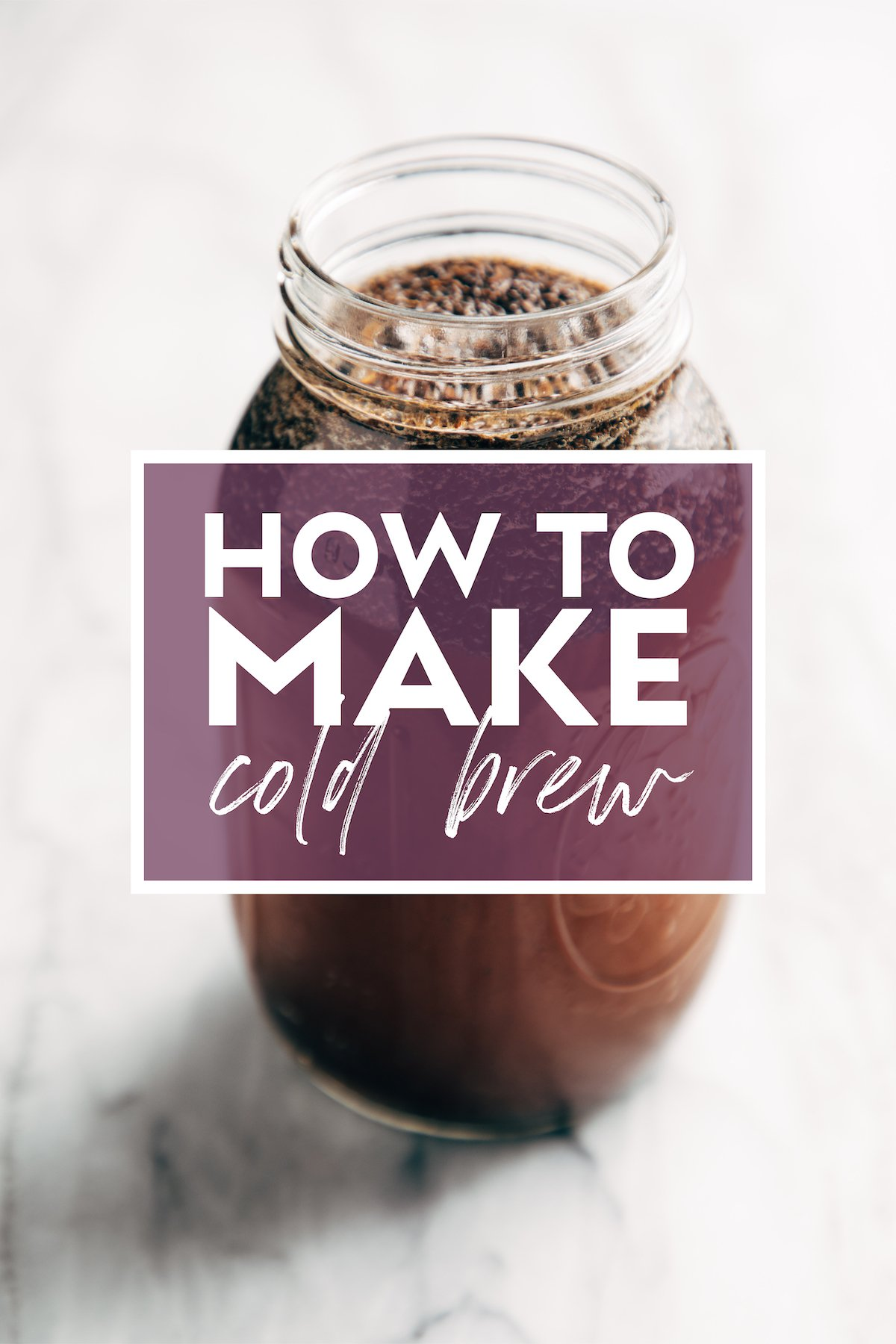 Image of a mason jar filled with coffee grounds and water steeping to make cold brew. There's text over the jar that says