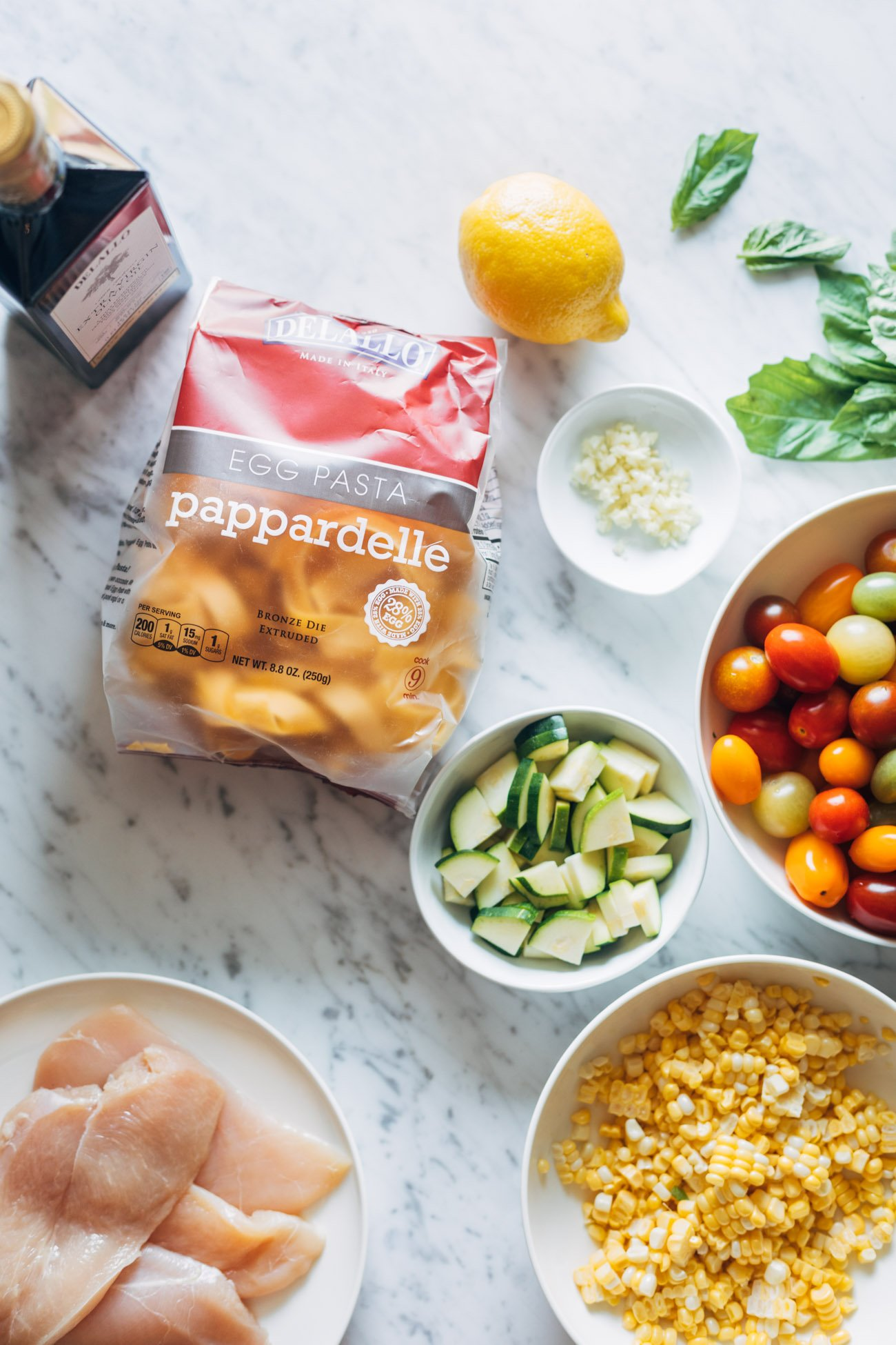 Overhead image of ingredients for Burst Tomato Pappardelle.