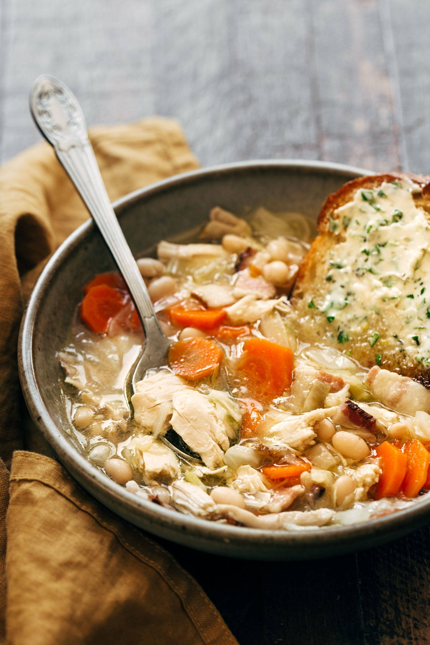 Chicken stew in a bowl with a spoon.