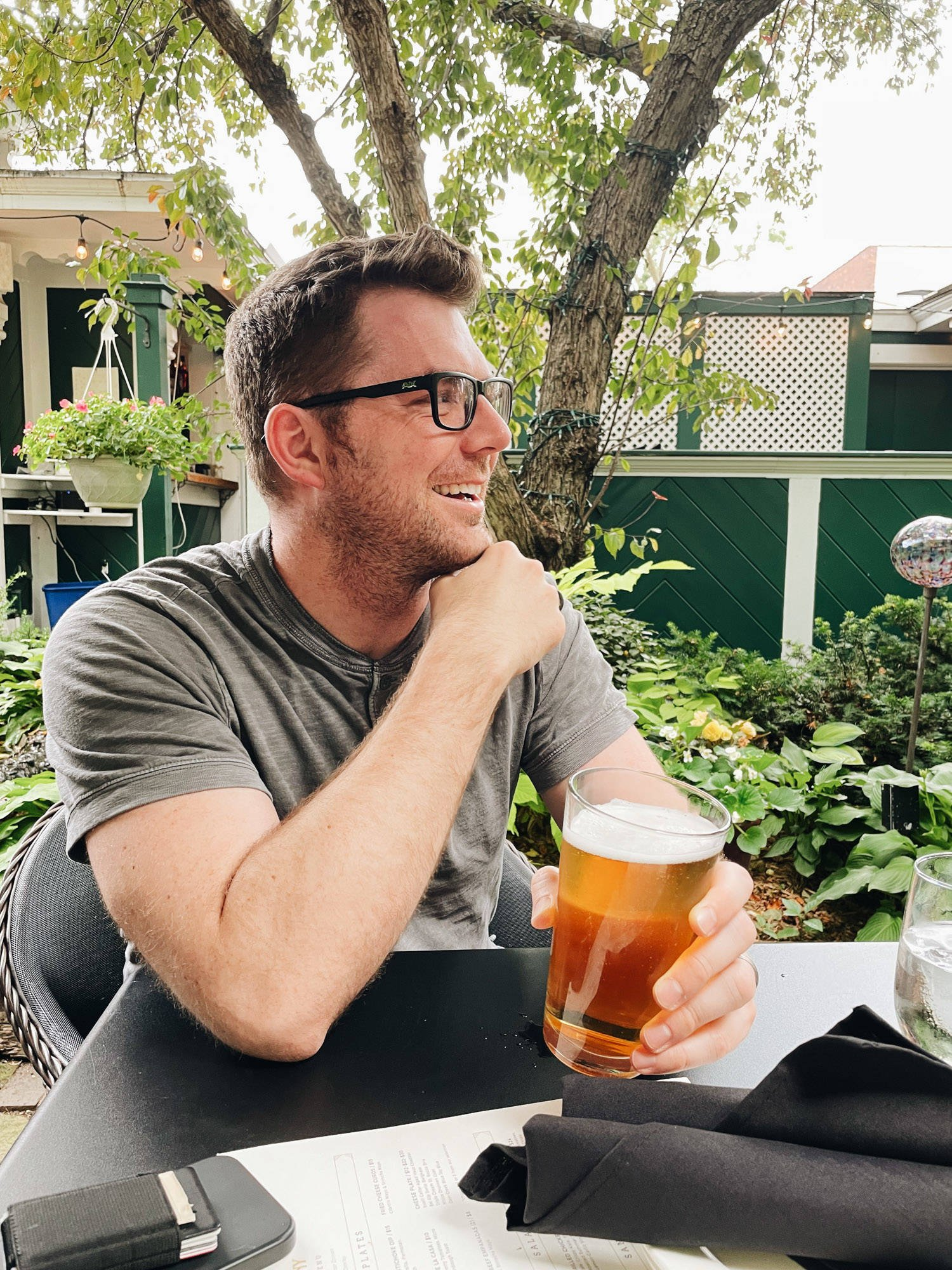 Man holding a beer and smiling.